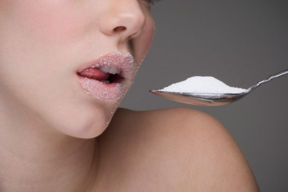Woman-eating-spoon-of-sugar
